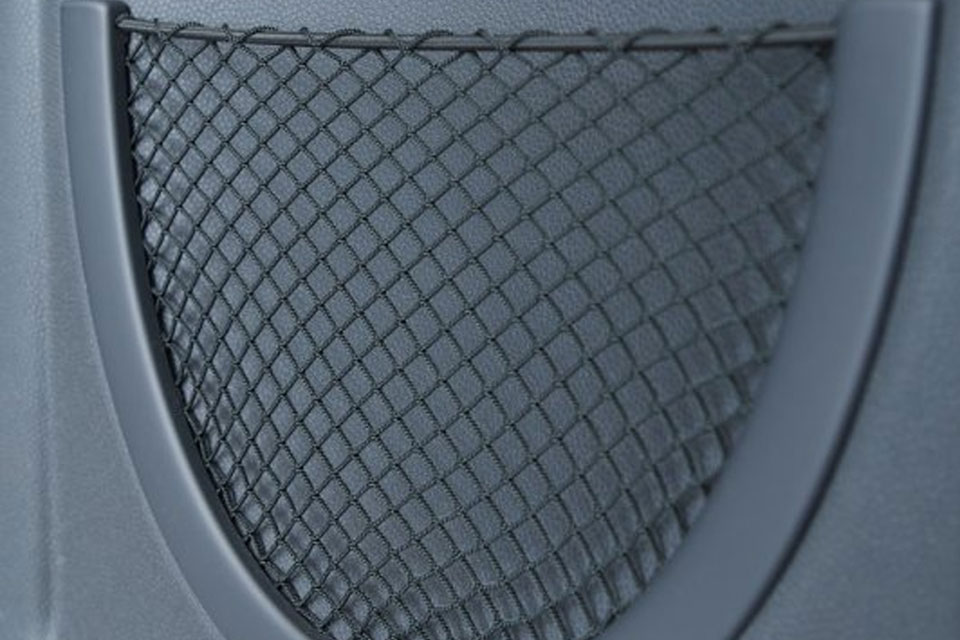 Backpanel with welded mesh pocket